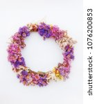 Small photo of first of May handmade colorful flowers wreath, soft and airy on white background with space for text or logo