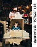kid happy sit in cardboard hand ... | Shutterstock . vector #1076234663