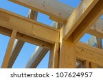 Part of wood house skeleton in construction site - stock photo