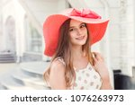 beautiful young woman in hat... | Shutterstock . vector #1076263973