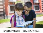 schoolchildren  reading the... | Shutterstock . vector #1076274263