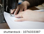 hands of woman working on the... | Shutterstock . vector #1076333387