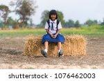 asian student in uniform... | Shutterstock . vector #1076462003