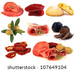 Italian cuisine, gourmet food, antipasti - prosciutto; salame, truffle, olive and sun-dried tomato isolated - stock photo