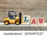 toy yellow forklift hold letter ... | Shutterstock . vector #1076497127