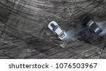 aerial top view car drifting... | Shutterstock . vector #1076503967
