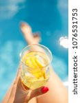 fresh lemonade near the pool | Shutterstock . vector #1076531753