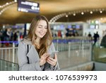 smiling woman typing message by ... | Shutterstock . vector #1076539973
