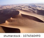 Small photo of The Libyan desert , Beautiful structure of dense yellow sand, dune of the huge sizes and deep sky of Sahara