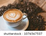 cup of coffee   latte art and... | Shutterstock . vector #1076567537
