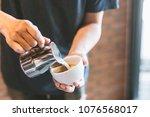closeup of male barista holding ... | Shutterstock . vector #1076568017