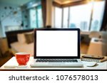 front view of cup and laptop on ... | Shutterstock . vector #1076578013