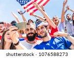 american fans taking a selfie... | Shutterstock . vector #1076588273