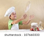 Boy With Chef Hat Preparing Th...