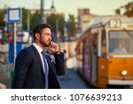 a handsome young businessman... | Shutterstock . vector #1076639213