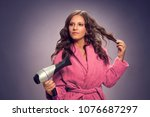 young woman with hairdryer... | Shutterstock . vector #1076687297