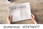 woman reading newspaper on... | Shutterstock . vector #1076746577