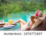 woman relaxing in tropical villa | Shutterstock . vector #1076771837