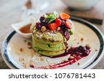 matcha pancakes with strawberry....   Shutterstock . vector #1076781443