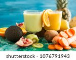 detox juices next to fruits and ...   Shutterstock . vector #1076791943