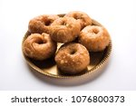 balushahi sweet food served in... | Shutterstock . vector #1076800373
