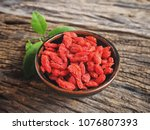 dried goji berry fruits on wood ...   Shutterstock . vector #1076807393