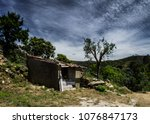 abandoned house surrounded by... | Shutterstock . vector #1076847173