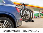car is transporting bicycles on ... | Shutterstock . vector #1076928617