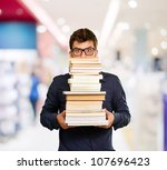 young man with books  indoor | Shutterstock . vector #107696423