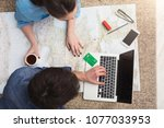 couple planning travel.... | Shutterstock . vector #1077033953