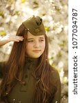 little girl in a military... | Shutterstock . vector #1077034787