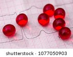 red pill on the cardiogram .... | Shutterstock . vector #1077050903