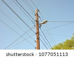 the post is electric with wires ... | Shutterstock . vector #1077051113