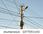the post is electric with wires ... | Shutterstock . vector #1077051143