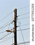the post is electric with wires ... | Shutterstock . vector #1077051203