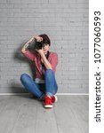 young female photographer with... | Shutterstock . vector #1077060593