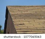 old damaged brown asphalt... | Shutterstock . vector #1077065063