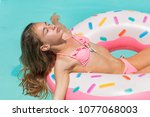young women in bikini swim on... | Shutterstock . vector #1077068003