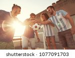 group of young friends having... | Shutterstock . vector #1077091703