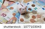 piggy bank closeup  money and... | Shutterstock . vector #1077103043