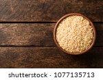 raw brown rice in ceramic bowl... | Shutterstock . vector #1077135713