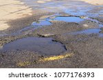 damaged pavement in parking lot. | Shutterstock . vector #1077176393