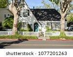 Small photo of Neighborhood House with Green Door