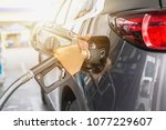 grey car at gas station being...   Shutterstock . vector #1077229607