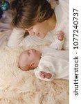 mother and newborn daughter lie ... | Shutterstock . vector #1077240737