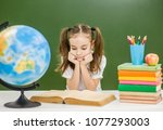 little girl with books... | Shutterstock . vector #1077293003