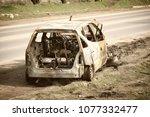 an abandoned  stolen burnt out... | Shutterstock . vector #1077332477