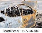 an abandoned  stolen burnt out... | Shutterstock . vector #1077332483