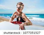 beautiful woman with a wine and ... | Shutterstock . vector #1077351527