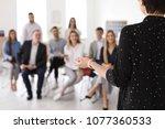 female business trainer giving... | Shutterstock . vector #1077360533